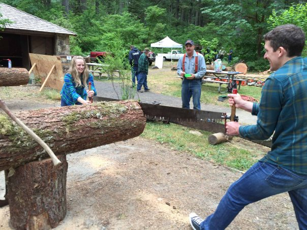 Couple on Crosscut Saw with Randy Hildebrandt